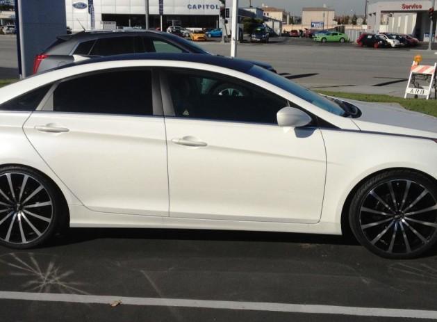 "20"" MSR (black/machined)wheels Tinted rear windows Carbon Fiber vinyl roof wrap Custom front grille"